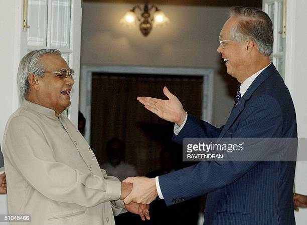 Singapore Prime Minister HE Goh Chok Tong gestures as he meets former Indian Prime Minister Atal Behari Vajpayee prior to a meeting at Vajpayee's...