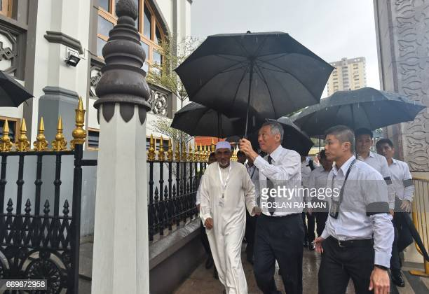 Singapore Prime MInister Lee Hsien arrives at Masjid Sultan to pay his last respects to late Othman Wok a member of independent Singapore's first...