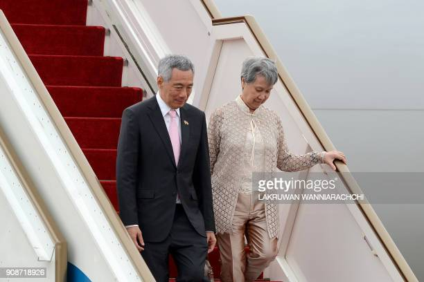Singapore Prime Minister Lee Hsien Loong and his wife Ho Ching arrive at the Bandaranaike International airport in Katunayake on January 22 2018...