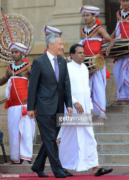 Singapore Prime Minister Lee Hsien Loong and Sri Lankan President Maithripala Sirisena attend a welcoming ceremony at the Presidential Secretariat in...