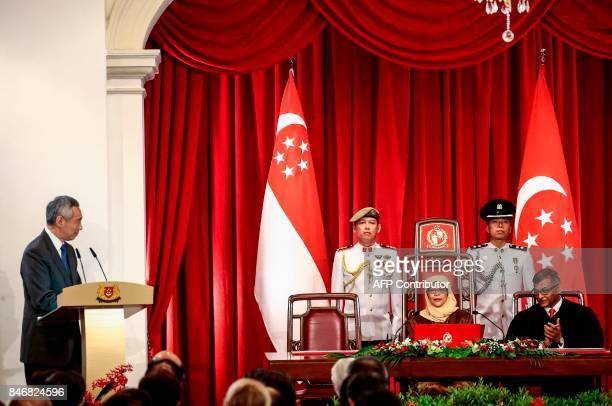 Singapore Prime Minister Lee Hsien Loong delivers his address as President Halimah Yacob and Chief Justice Sundaresh Menon look on during the...