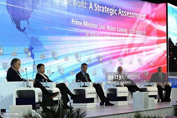 Singapore Prime Minister Lee Hsien Loong delivers his address alongside chairman of PricewaterhouseCoopers International Dennis Nally chairman of...