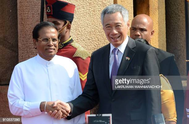 Singapore Prime Minister Lee Hsien Loong shakes hands with Sri Lankan President Maithripala Sirisena during a welcoming ceremony at the Presidential...