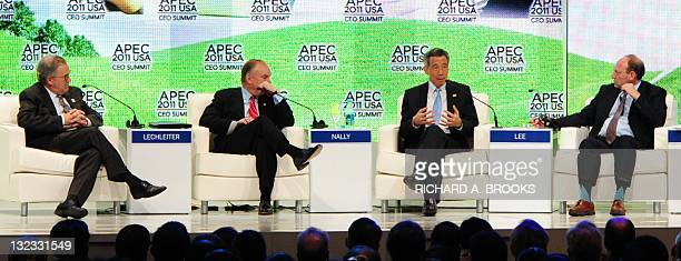 Singapore Prime Minister Lee Hsien Loong speaks as chairman of PwC International, Dennis Nally , Eli Lily president and CEO John Lechleiter and...