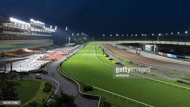 singapore racecourse at night - horse racecourse stock photos and pictures