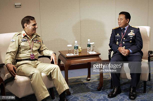 General EhsanulHaq chairman Chiefs of staff Committee of Pakistan chats with Indonesian Air Marshal Djoko Suyanto commander inchief for National...