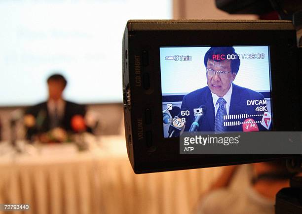 Genting Group chairman Lim Kok Thay is seen through a video camera as he speaks at a press conference on Sentosa Island in Sinagpore 11 December 2006...