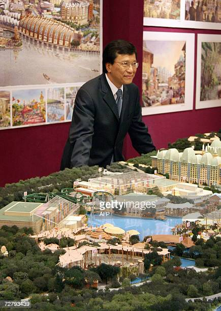Genting Group chairman Lim Kok Thay poses next to the proposed model for the Integrated Resort on Sentosa Island in Sinagpore 11 December 2006 Shares...