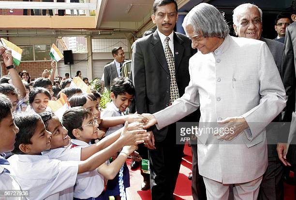 Indian President Avul Pakir Jainulabdeen Abdul Kalam greets school children during his visit to Bhavan's Global Indian International School in...