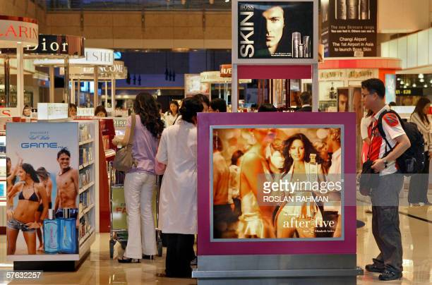 People shop for comestics and perfumes at a dutyfree mall in Singapore 15 May 2006 A swelling pool of affluent consumers in China and elsewhere in...