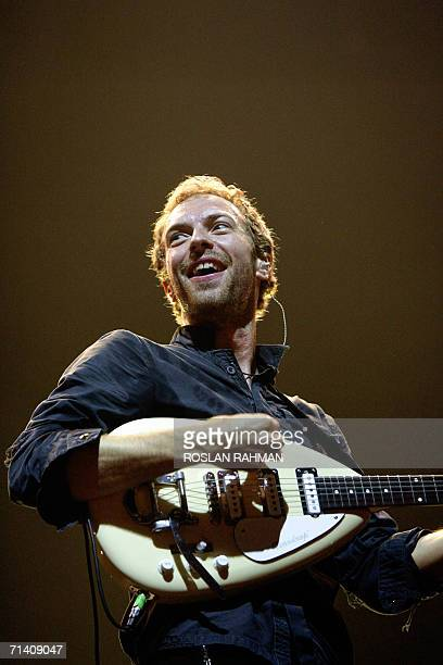 Singer Chris Martin of the Coldplay band performs at the Singapore Indoor Stadium, 10 July 2006. The internationally-acclaimed British music group...