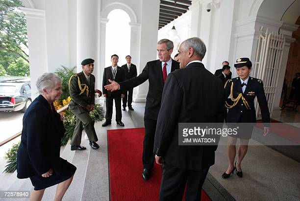 US President George W Bush introduces US Ambassador to Singapore Patricia Herbold as they arrive at the The Istana to meet with Acting President of...