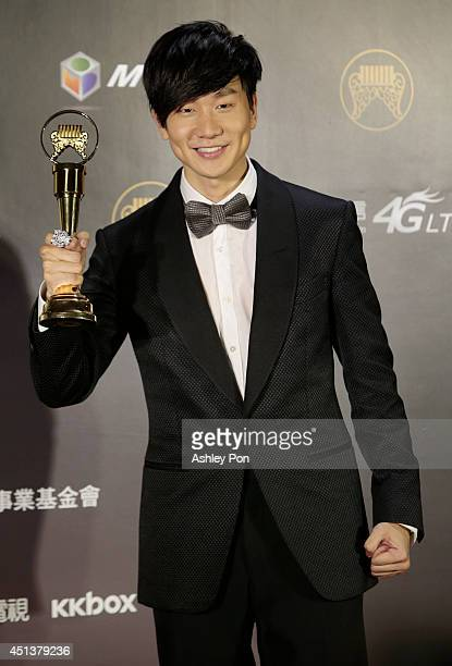 Singapore singer JJ Lin holds his award for Best Male Mandarin singer at the 25th Golden Melody Awards on June 28 2014 in Taipei Taiwan