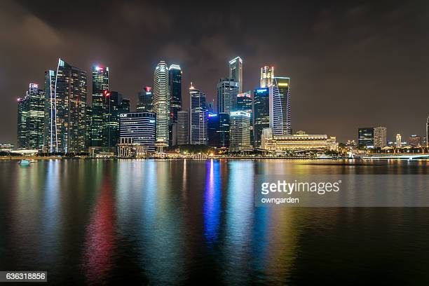 singapore skyline at night - singapore flyer stock photos and pictures