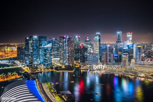 singapore skyline at night - asia pac stock pictures, royalty-free photos & images