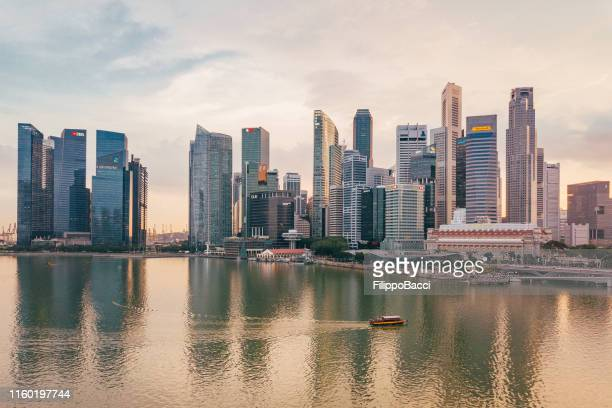 singapore skyline at sunset - aerial point of view - singapore city stock pictures, royalty-free photos & images