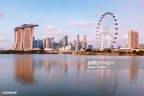 singapore skyline reflected in the water, singapore - singapore city stock pictures, royalty-free photos & images