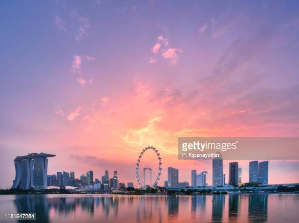 singapore skyline sunset - singapore city stock pictures, royalty-free photos & images