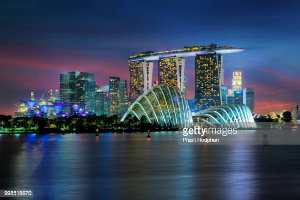 singapore skyscraper building at marina bay in night, singapore. - marina bay sands stock photos and pictures