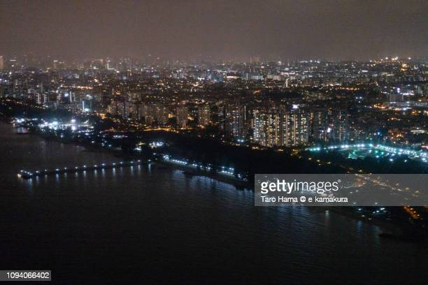 Singapore Strait and city night time aerial view from airplane