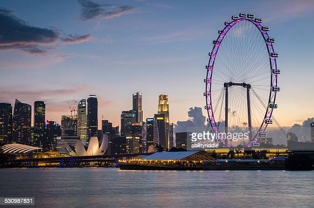 singapore sunset - singapore flyer stock photos and pictures