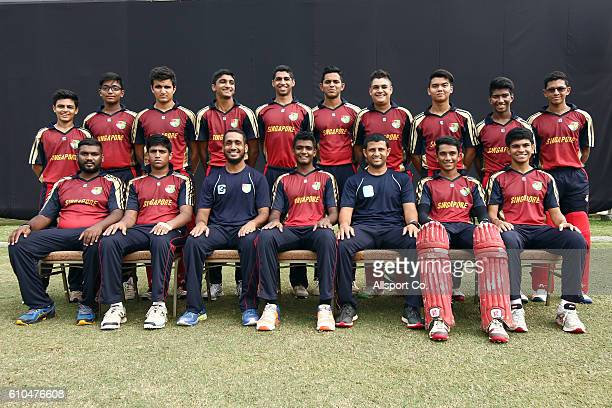 Singapore team poses prior to start of the 2018 Under19 Cricket World Cup qualification Division 2 match between Malaysia and Singapore at the...