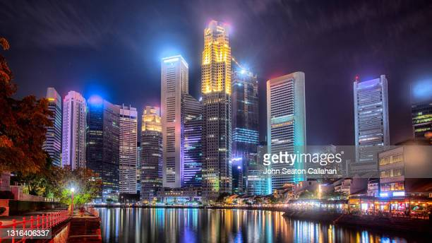 singapore, the singapore river at boat quay - tropical climate stock pictures, royalty-free photos & images