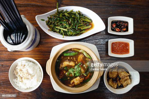 Singaporean Chinese food knolling on a wooden table