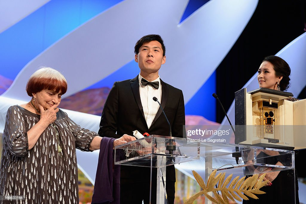 Singaporean director Anthony Chen (C) poses on stage with director Agnes Varda and Chinese actress and member of the Un Certain Regard Jury Zhang Ziyi after winning the Camera d'Or for Best First Film at the Inside Closing Ceremony during the 66th Annual Cannes Film Festival at the Palais des Festivals on May 26, 2013 in Cannes, France.