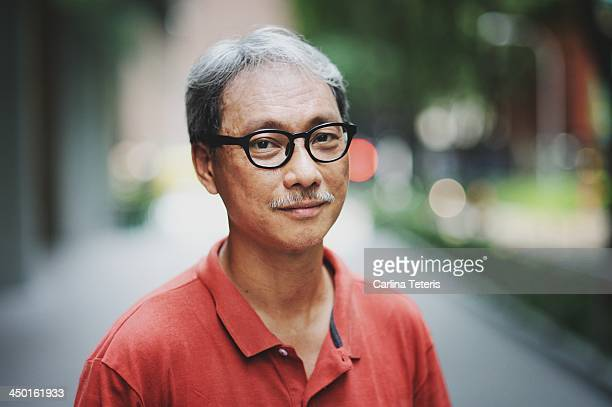 singaporean man - differential focus stock pictures, royalty-free photos & images