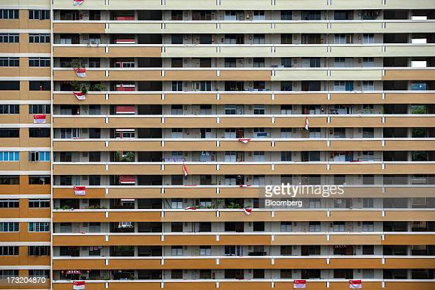 Singaporean national flags hang from corridor railings at a public housing block in the Redhill area of Singapore on Tuesday July 9 2013 Singapore...