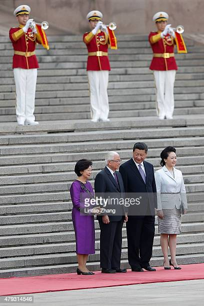 Singaporean President Tony Tan Keng Yam and his wife Mary Tan with Chinese President Xi Jinping and his wife lady Peng Liyuan attend a welcoming...