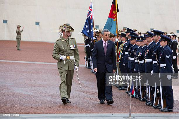 Singaporean Prime Minister Lee Hsien Loong inspects Australian troops at the Welcoming Ceremony at Parliament House on October 11 2012 in Canberra...
