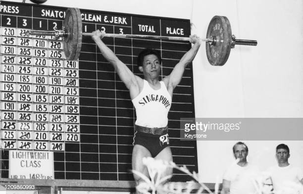 Singaporean weightlifter Tan Howe Liang competing in the Lightweight event at the 6th Commonwealth Games in Barry Wales 24th July 1958 Tan won the...