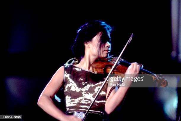 Singaporean-born British Classical and Pop musician Vanessa-Mae plays violin as she performs onstage at the Ravinia Festival, Highland Park,...