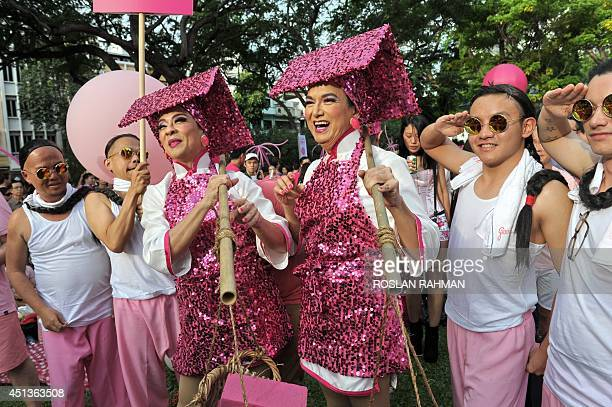 Singaporeans dress in pink in support of gays and lesbians as they gather at 'Speakers' Corner' in Singapore on June 28 2014 A gay rights rally was...
