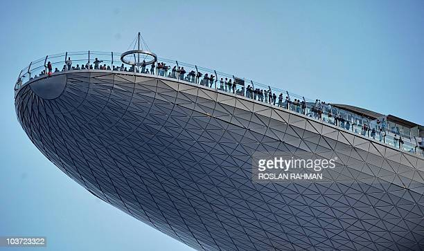"Singapore-economy-tourism-gaming"" by Martin Abbugao A picture taken on August 26, 2010 shows visitors looking at the view from the skypark of the..."