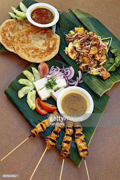 Singapore's Banana Leaf in the Farmer's Market Photo of dishes with Satay Parathas with vegetable curry sauce and Rojak March 2 2003