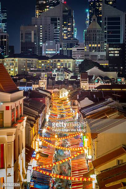 singapore's chinatown night bazaar - singapore stock pictures, royalty-free photos & images