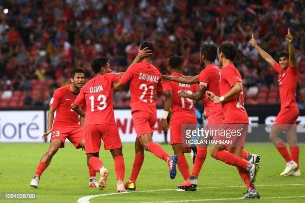 Singapore's defender Safuwan Baharudin celebrates a goal with teammates during the 2018 AFF Suzuki Cup football match between Singapore and East...
