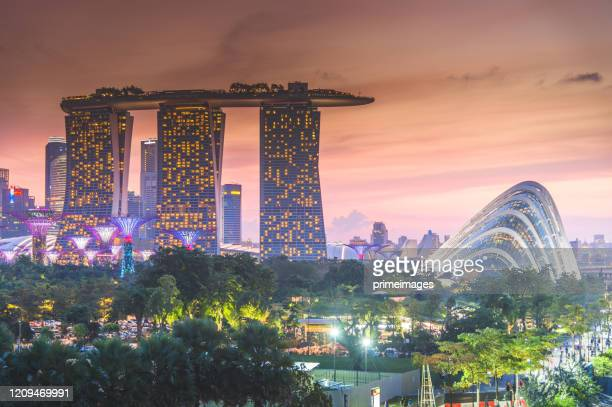 singapore's famous view of marina bay is a popular tourist attraction in the marina district of singapore. - marina bay sands skypark stock pictures, royalty-free photos & images