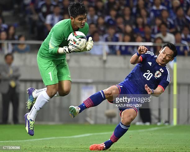 Singapore's goalkeeper Mohamad Izwan Bin Mahbud catches the ball against Japan's defender Tomoaki Makino during the 2018 FIFA World Cup football...