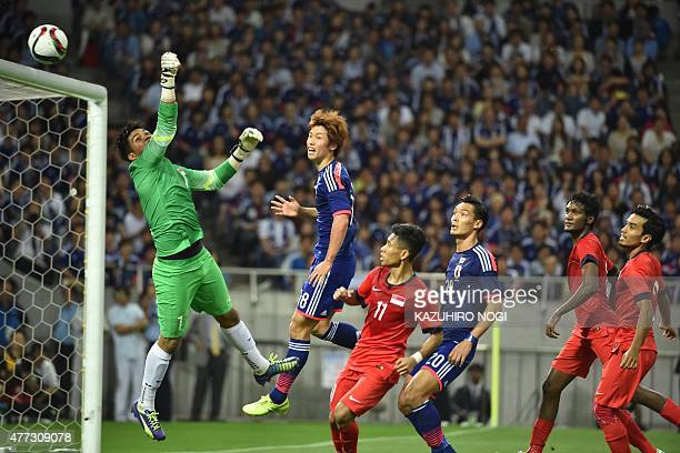 Singapore's goalkeeper Mohamad Izwan Bin Mahbud hits the ball away from the goalpost during the 2018 FIFA World Cup football qualifying match between...