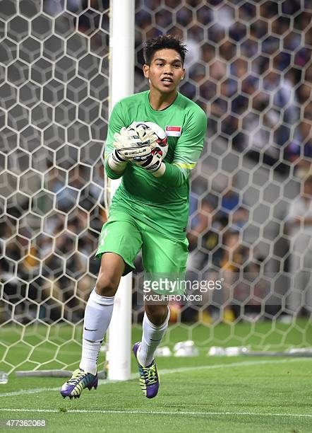 Singapore's goalkeeper Mohamad Izwan Bin Mahbud holds the ball during the second round Group E 2018 World Cup Asian qualifier football match against...
