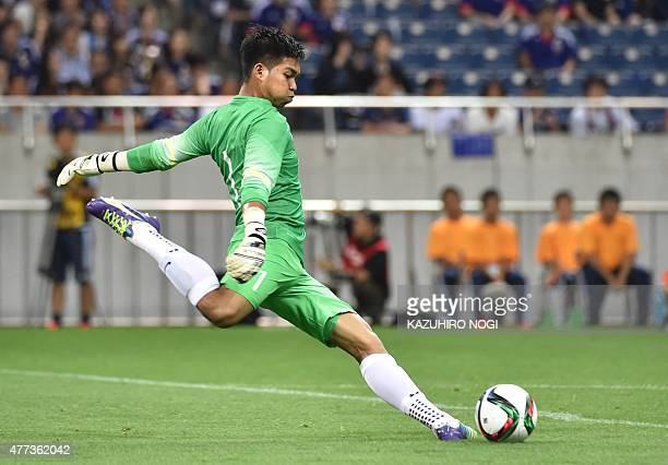Singapore's goalkeeper Mohamad Izwan Bin Mahbud kicks the ball during the second round Group E 2018 World Cup Asian qualifier football match against...