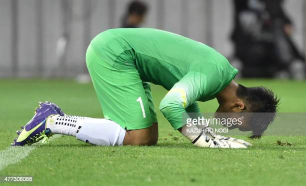 Singapore's goalkeeper Mohamad Izwan Bin Mahbud reacts following the 2018 FIFA World Cup football qualifying match between Japan and Singapore in...