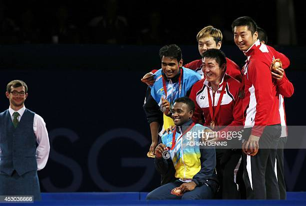 Singapore's gold medalists Gao Ning and Li Hu India's silver medalists Sharath Kamal Achanta and Amalraj Anthony Arputharaj and Singapore's bronze...