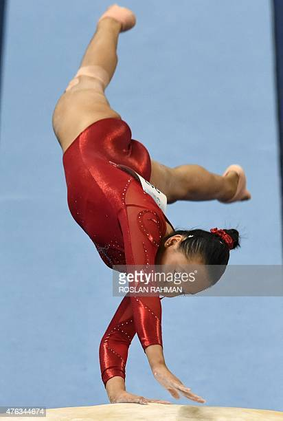 Singapore's Janessa Dai competes on the vault during the women's individual allaround gymnastics final at the 28th Southeast Asian Games in Singapore...