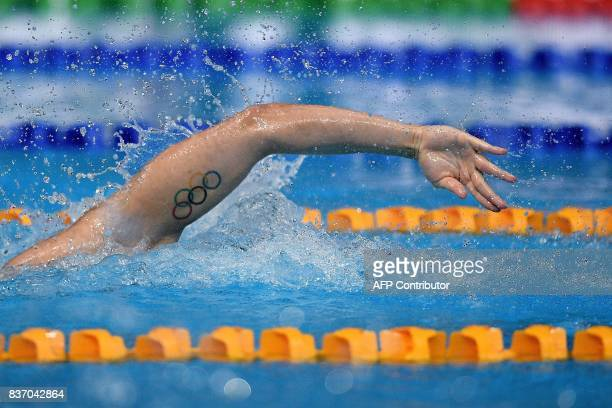 TOPSHOT Singapore's Joseph Schooling competes in the men's swimming 4 X 100m freestyle relay final of the 29th Southeast Asian Games at the National...