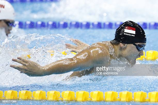 TOPSHOT Singapore's Joseph Schooling competes to win the Men's 100m Butterfly Final during the swimming event at the Rio 2016 Olympic Games at the...